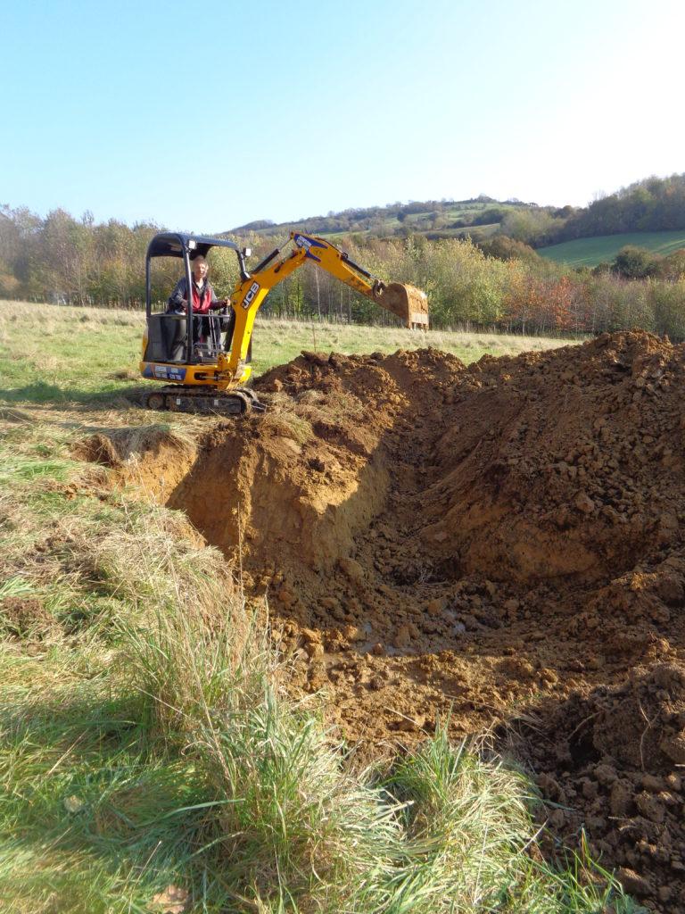 Digging a pond using a mini-digger
